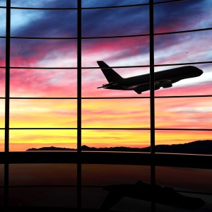 http://www.dreamstime.com/stock-photos-airport-window-airplane-flying-sunset-image30281883