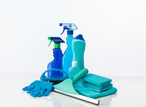 still life with cleaning supplies with different shades of blue, on white background